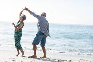 Elderly dancing in sand